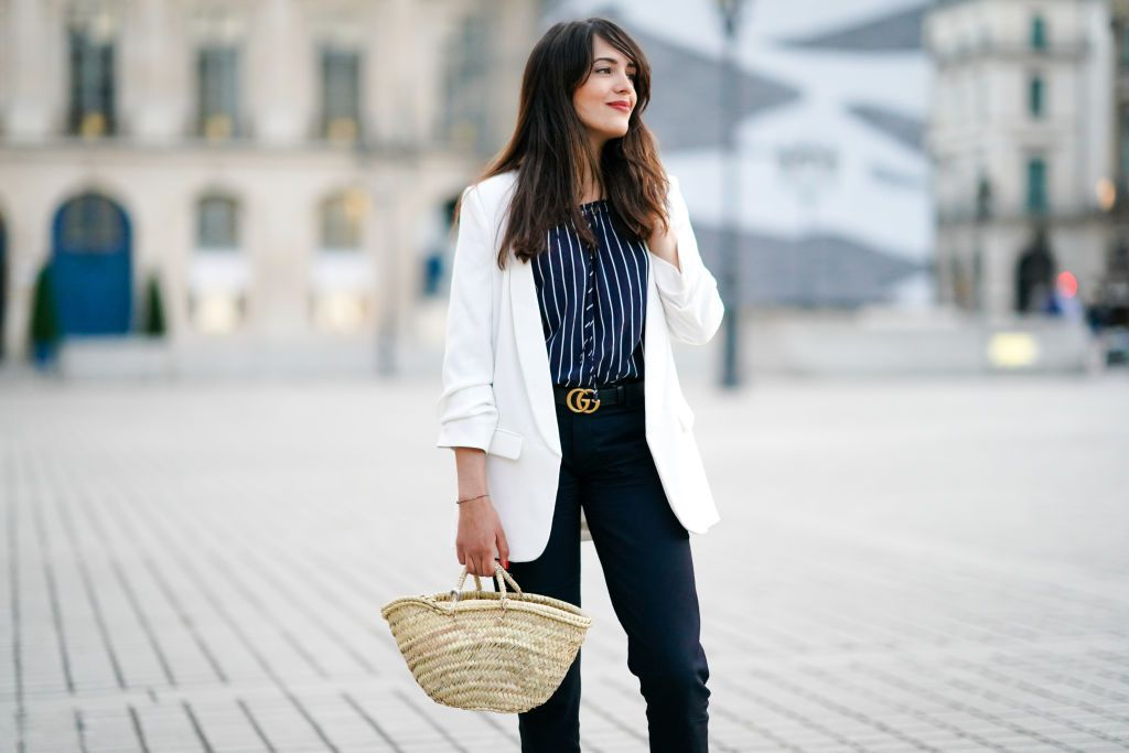 Woman in white blazer and jeans
