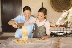Italian grandmother and granddaughter cooking together