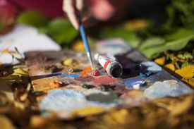 Person painting outdoors