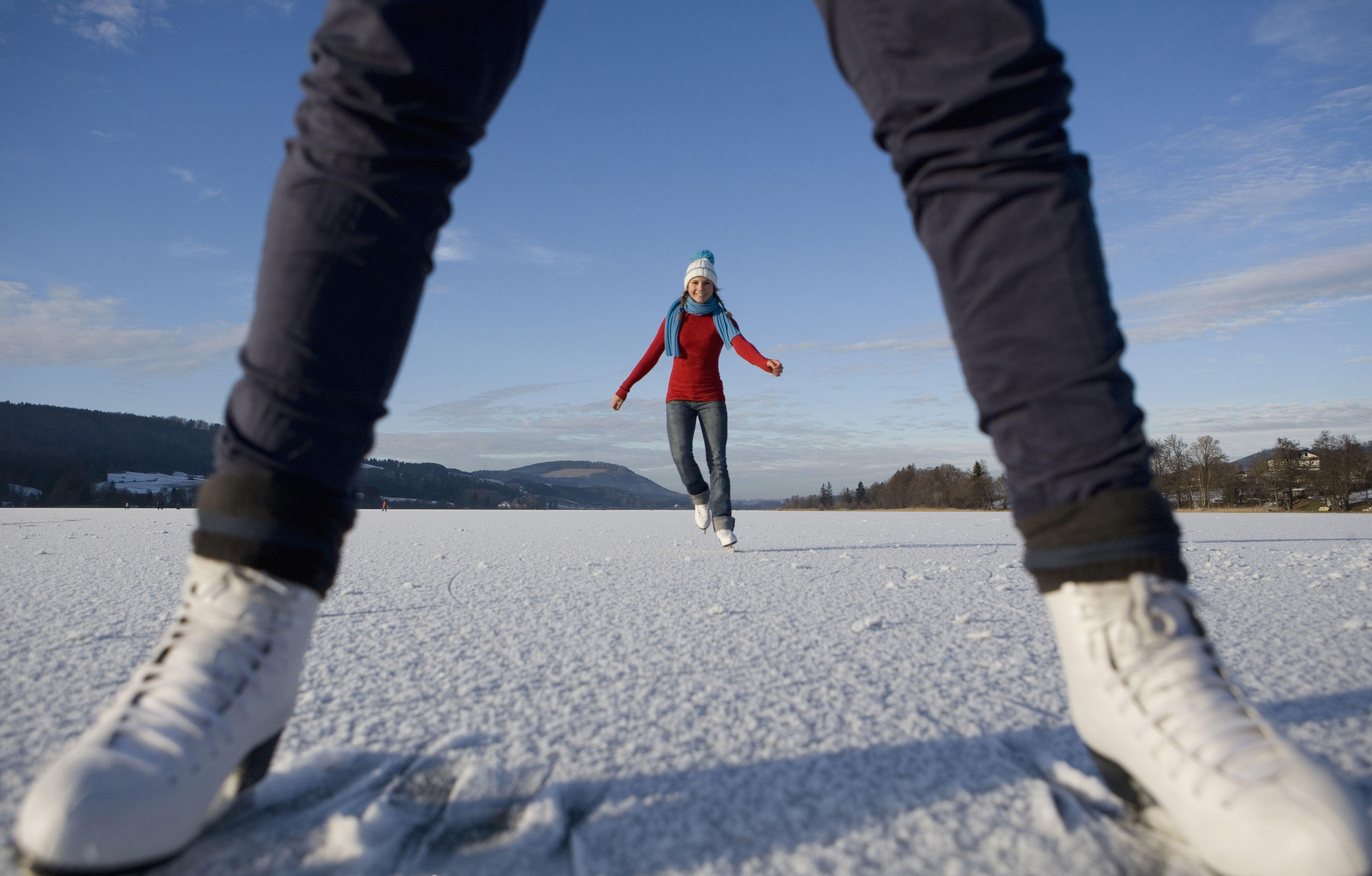 Austria, Salzkammergut, Lake Irrsee, Teenage girls (14-15) skating