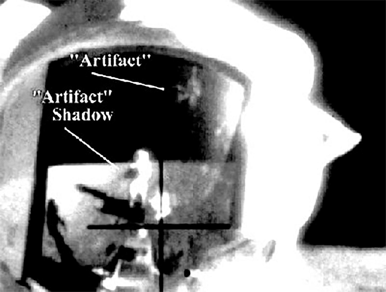 An odd reflection in an Apollo 12 astronaut's helmet.