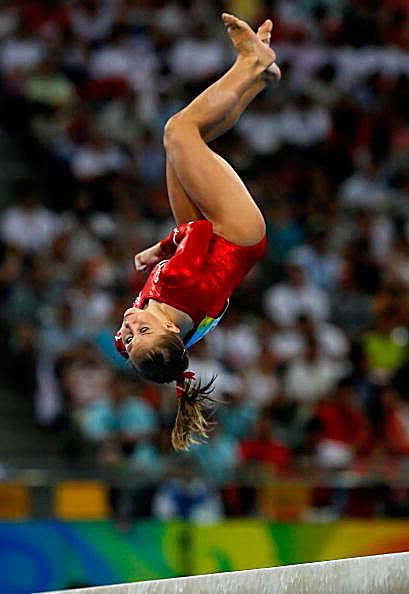 Gymnast Shawn Johnson performs on beam at the 2008 Olympic Gymnastics competition