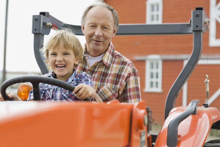 Grandparent and grandchild in a truck