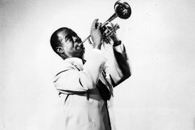Louis Armstrong plays the trumpet