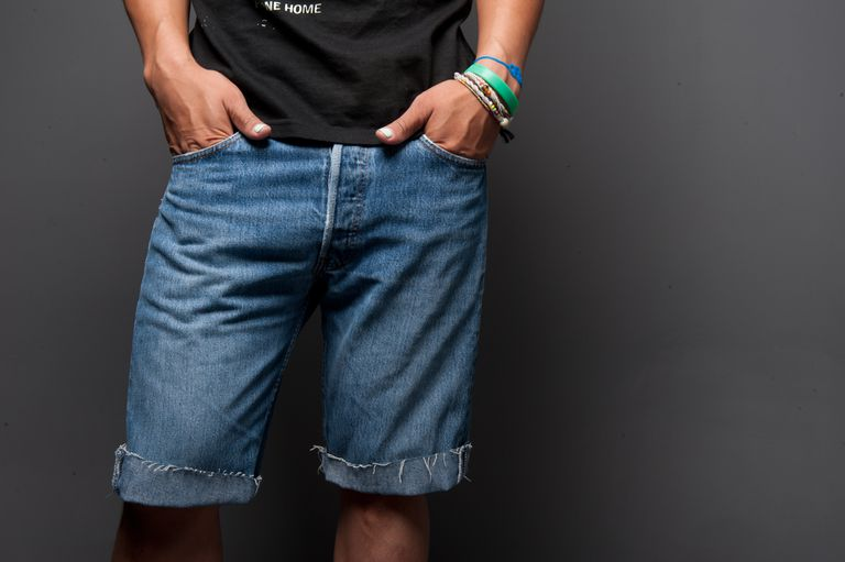 Man wearing cutoffs