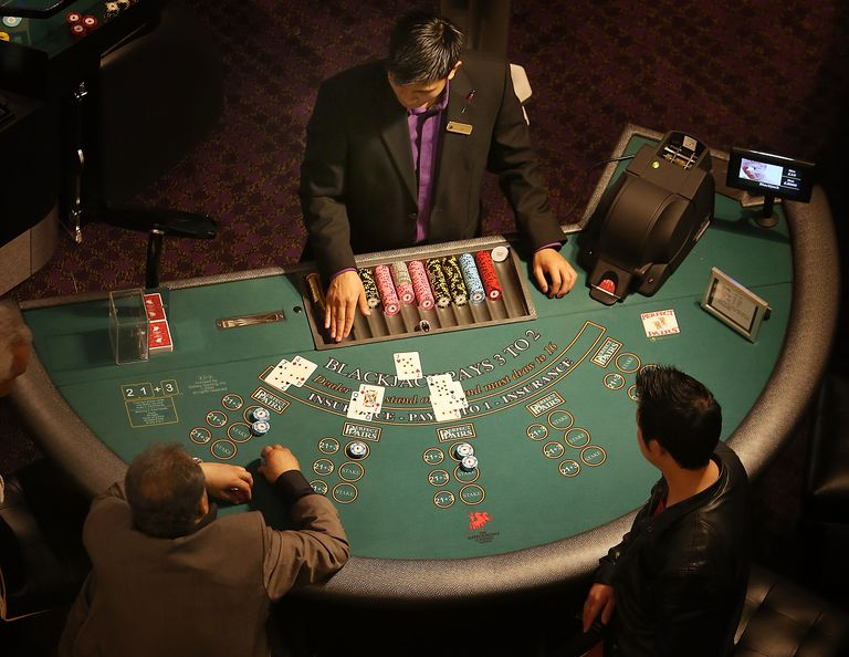 Dealer and players at blackjack table