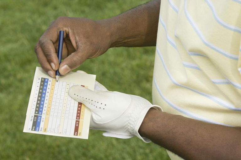 Golfer making score card