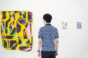 Person staring at a painting