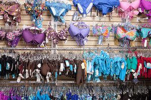 Bathing suits on wall in store