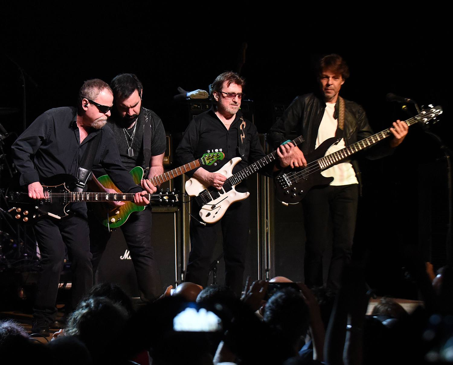 Eric Bloom, Richie Castellano, Donald 'Buck Dharma' Roeser, and Kasim Sulton of Blue Oyster Cult perform
