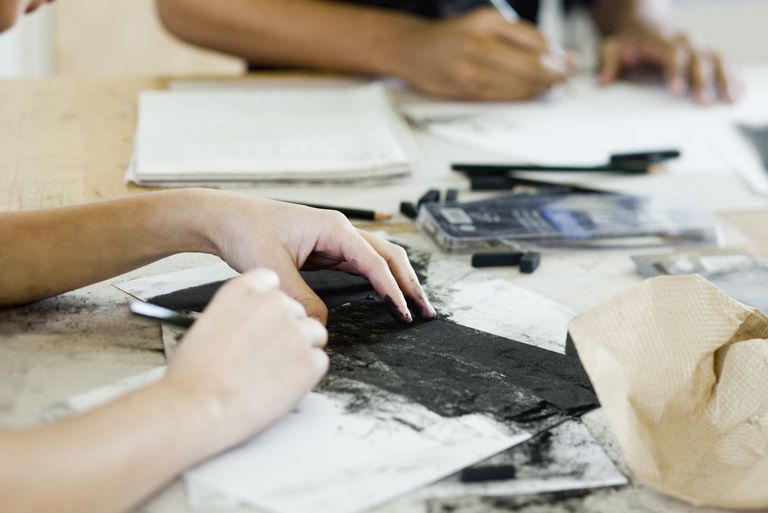 Art students drawing with charcoal