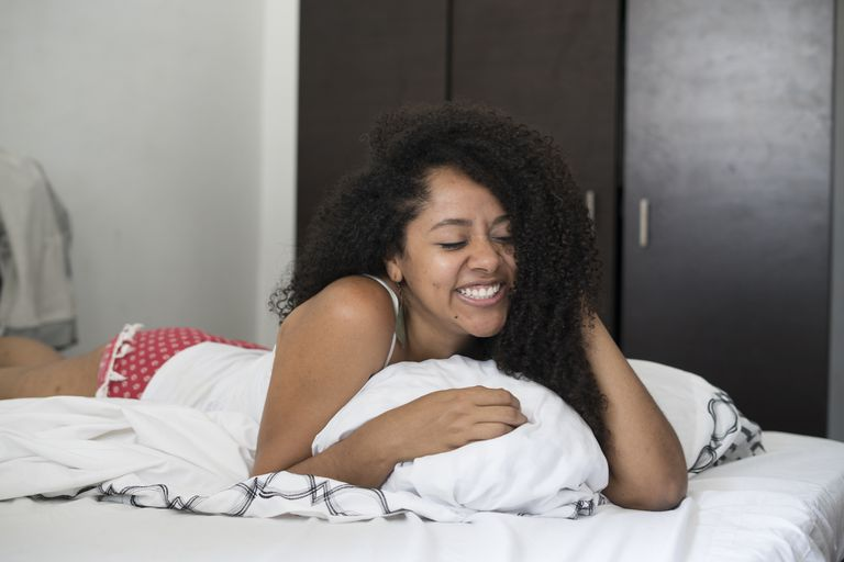 Woman Confident in Bed
