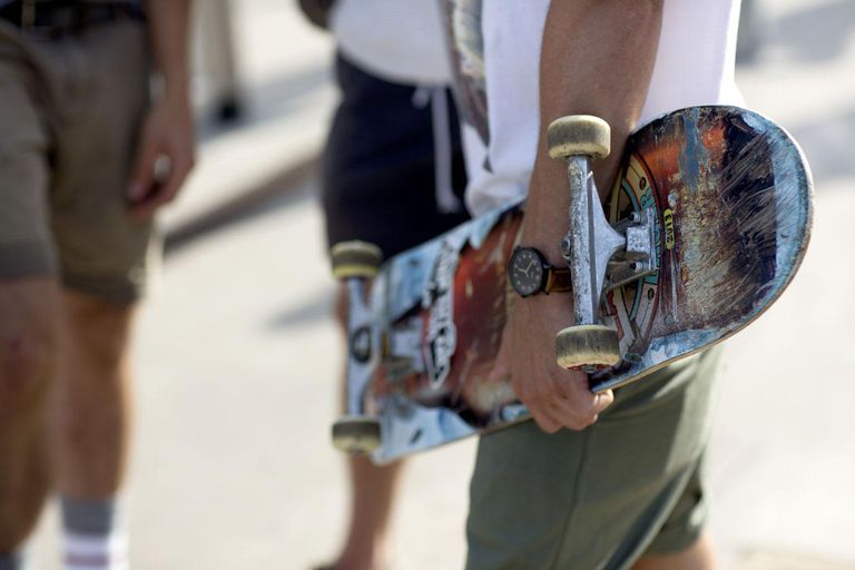 Young man holds skateboard