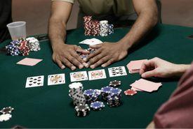 Hands of men playing poker