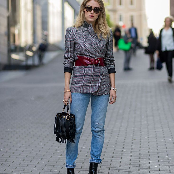 Street style fashion belted jacket over denim