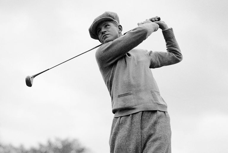 Golfer Horton Smith swings the club
