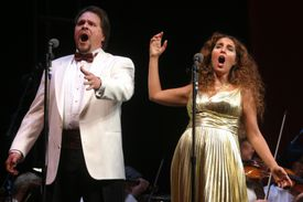 A Metropolitan Opera production with Mark Delavan as Rigoletto and Norah Amsellem as Gilda performing Verdi's 'Rigoletto' at Central Park's Great Lawn on Wednesday night, August 23, 2006.