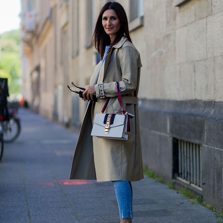 Street style in Gucci purse and jeans