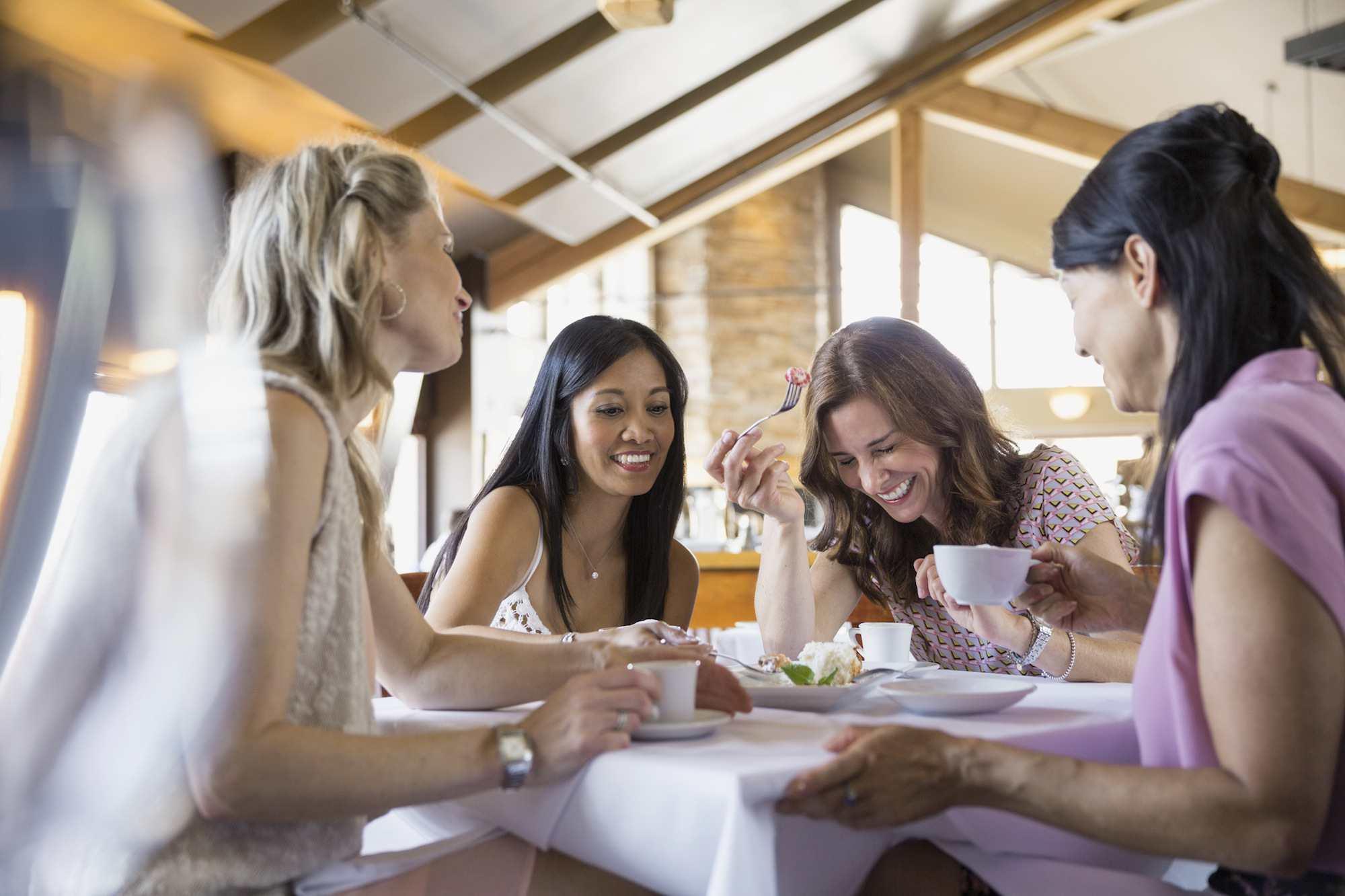 Women eating together in restaurant