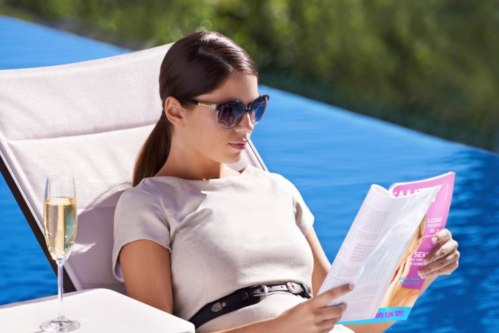 A model reading a fashion magazine