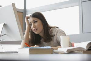 Frustrated college student studying at computer