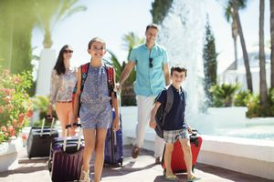 Family with suitcases going on vacation