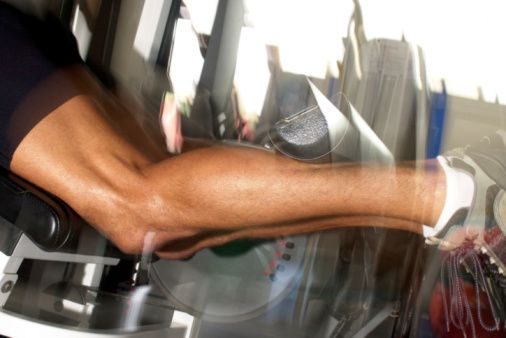 lower half of man doing calf raises
