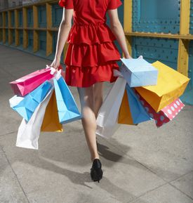 Photo of a woman with shopping bags, illustrating About.com's Gift Card Sweepstakes List.