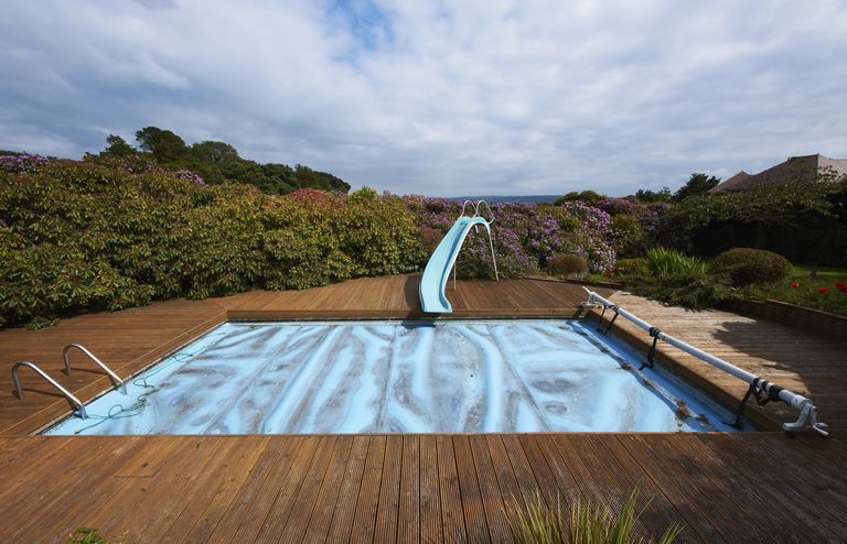 Covered swimming pool with slide