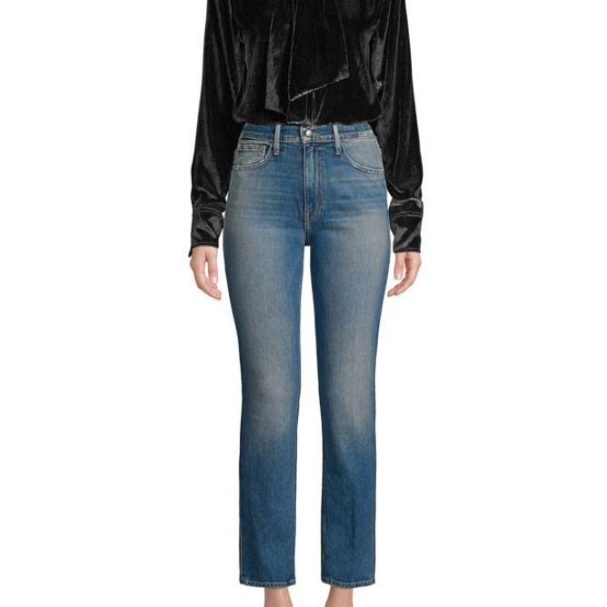 Woman in jeans and velvet shirt