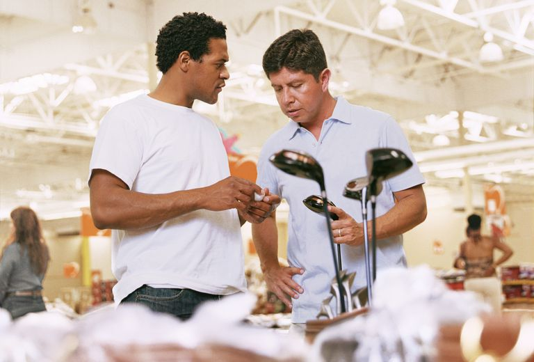 Two golfers checking out the selection in a store