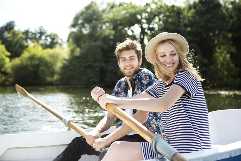 Couple Rowing a Boat