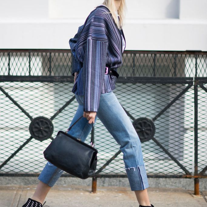 Street style in cropped jeans and ankle boots
