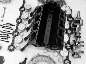High Angle View Of Car Engine On Table.