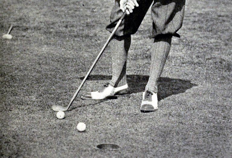 Detail from a photo that appeared in a 1913 golf instruction book by Jerome Travers shows Travers preparing to chip his stymied ball over the stymie his opponent laid for him.