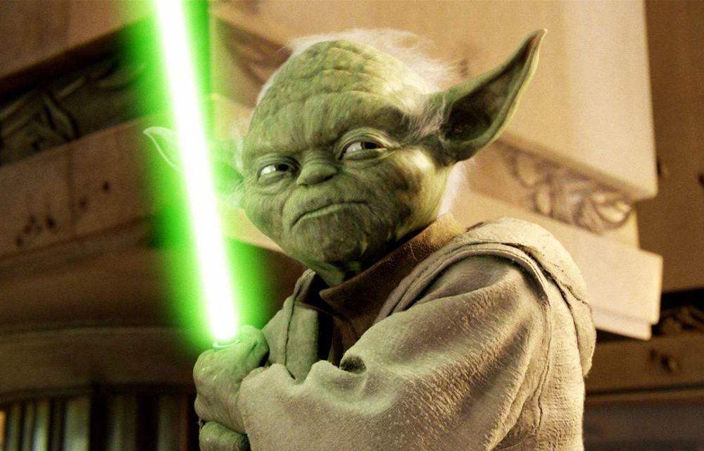 Yoda and his green lightsaber at the Jedi Temple
