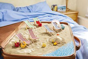 English seaside scene inside a suitcase, bedroom