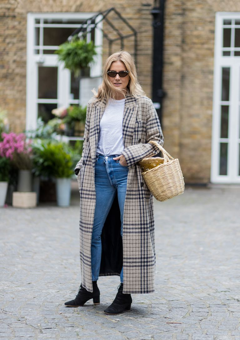 227af2bc3a Street style woman in plaid coat and jeans and t-shirt