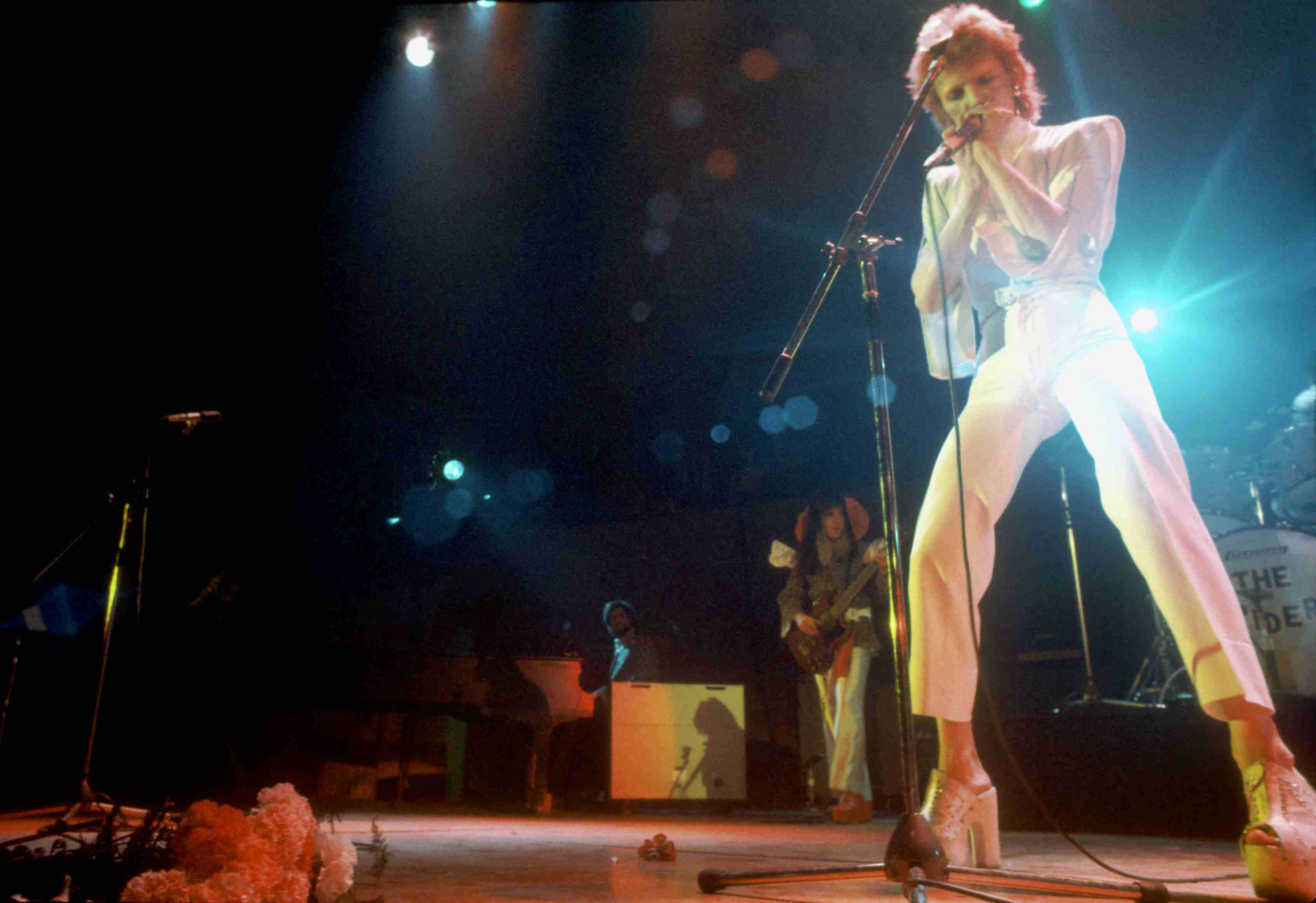 David Bowie singing on stage.
