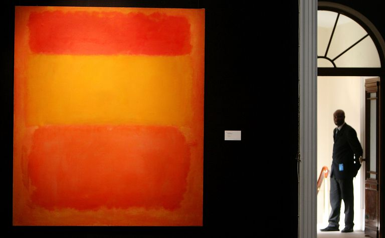 Abstract painting in shades of orange, red, and yellow on display