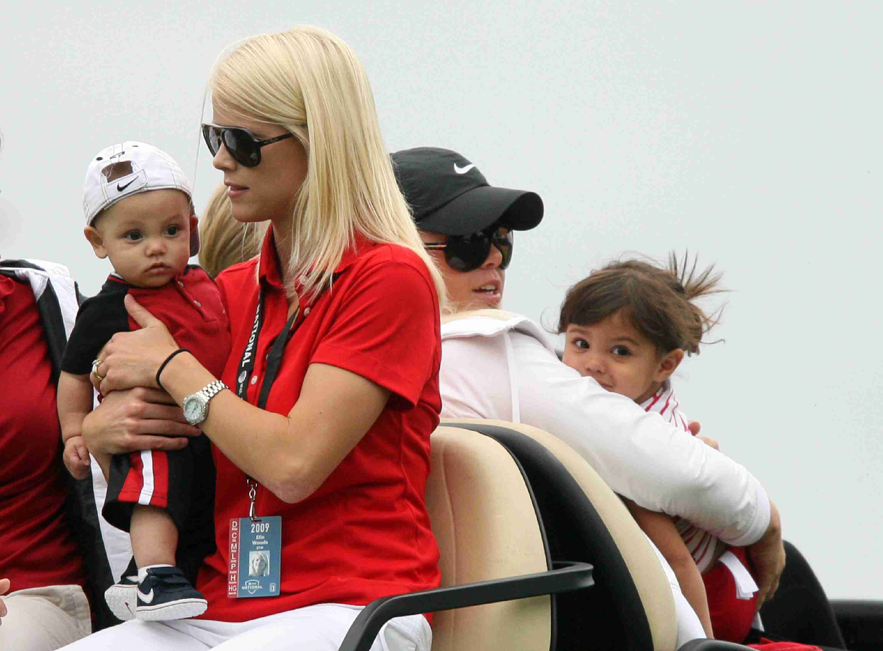 Charlie Woods, Elin Woods, Josefin Nordegren and Sam Woods ride in a golf cart at the 2009 AT&T National