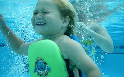 Swim Lessons And Dunking Young Children