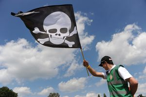 A marshall waves a skull flag during the Zone Golf Charity Shoot Out event in London