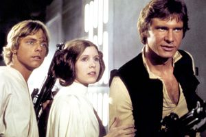 Actors Mark Hamill, Carrie Fisher, and Harrison Ford on the set of the space opera movie 'Star Wars' (1977)