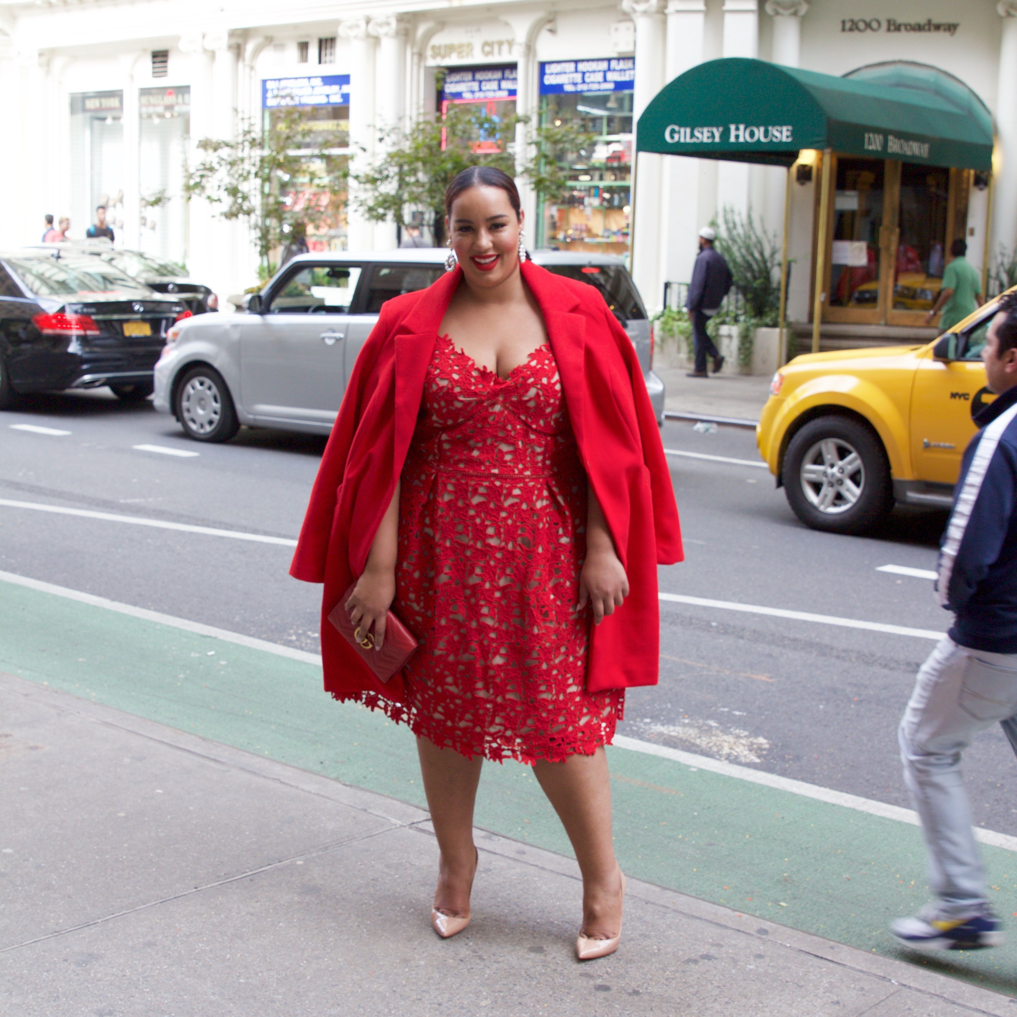 Woman in red dress and red coat
