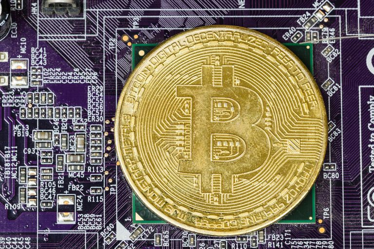 Bitcoin Lotteries Represented by a Bitcoin Against a Circuitboard