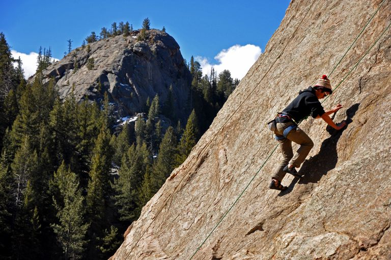A climber edges up a route on a toprope on Elevenmile Dome in Elevenmile Canyon.