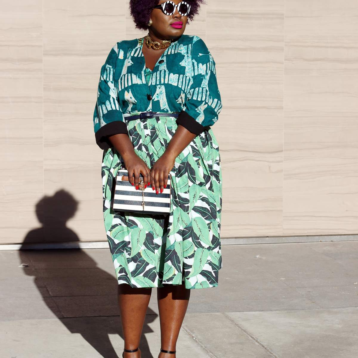 Woman in green printed summer dress