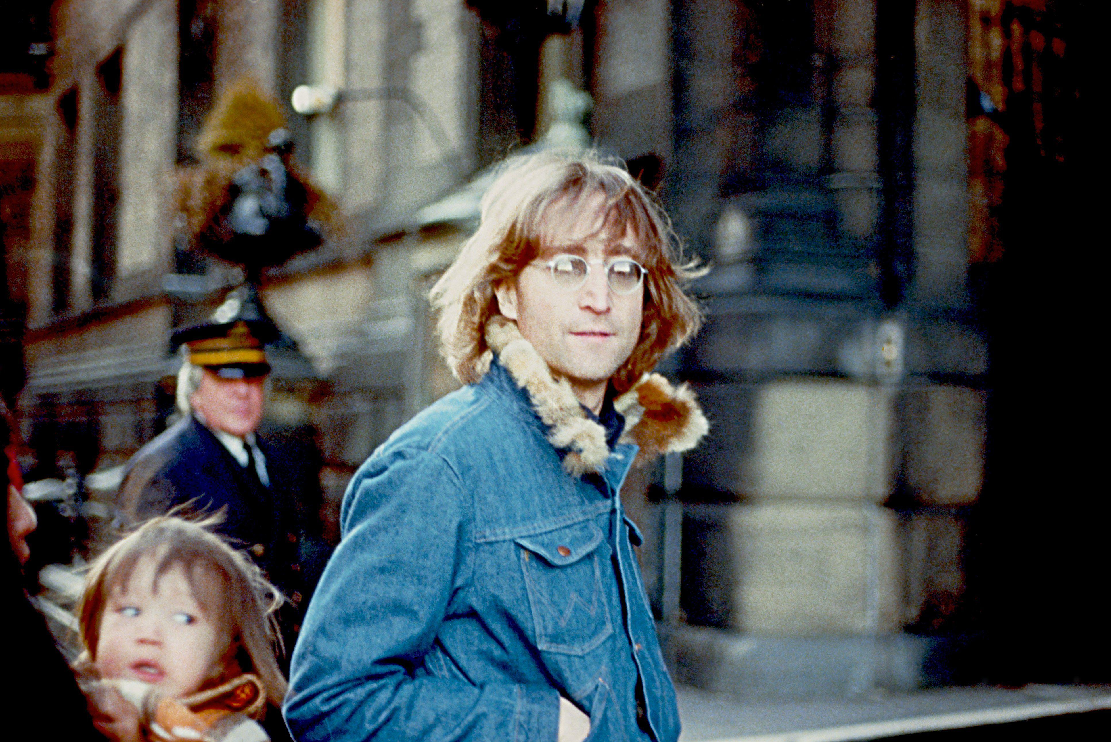 John Lennon looking at camera, full color photograph.
