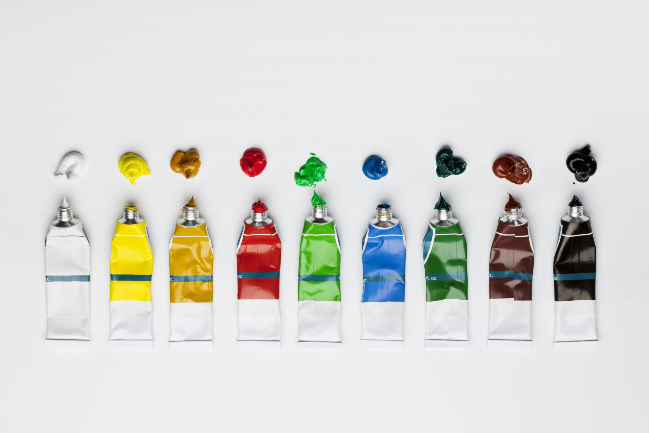 Opened tubes of paint.